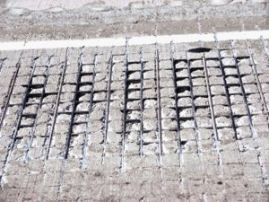 The crumbling concrete and exposed metal grate of the multimillion dollar repair job.