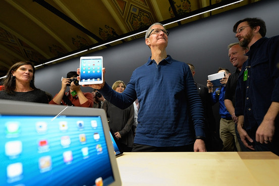 Apple CEO Tim Cook displays the new iPad Mini tablet, which is priced starting at $329.