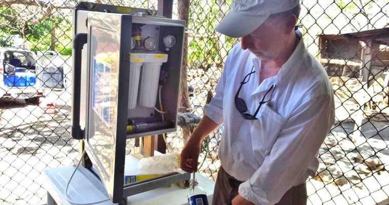 Jim Ryan, taking water samples in community Agua Caliente de Bagaces, February 2013