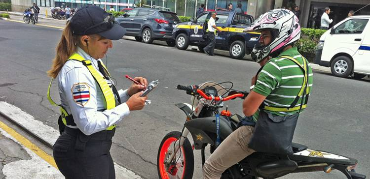 A Transito (traffic official) writing up a ticket
