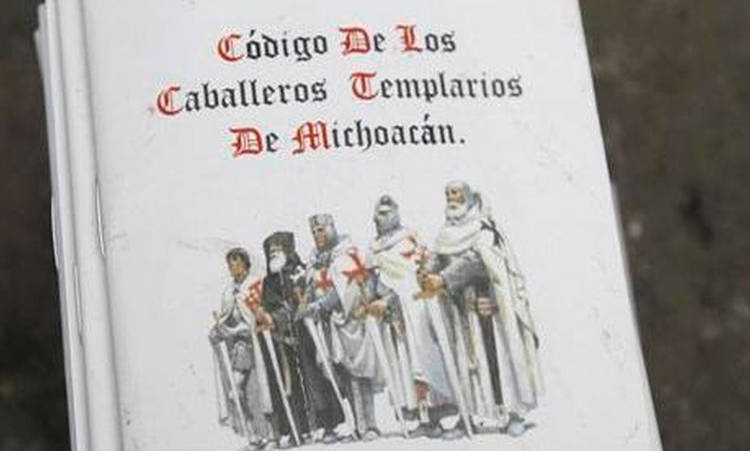 "A booklet reading ""Code of the Caballeros Templarios (Knights Te"