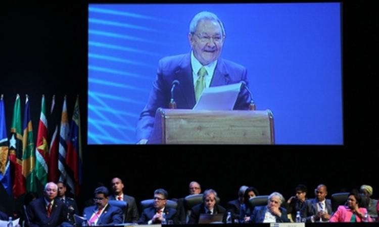 Raúl Castro on a screen above delegates at the Celac conference. Photograph: Ismael Francisco/AP