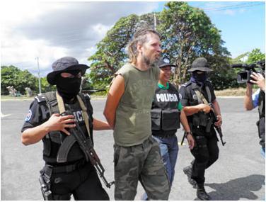 Papp gets led by Nicaraguan police (photo/ Nicaraguan police)