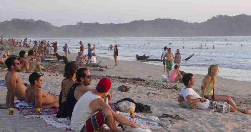 Tourist in Playa Guiones during the month of January. Photo by Ariana Crespo.