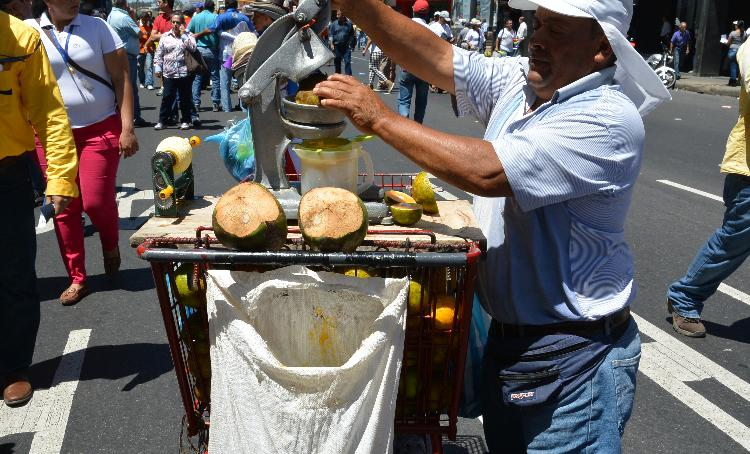 "The real winners Tuesday were the street vendors, hawking hats, horns and refreshments, all for ""todo a mil"" (for a thousand colones)."