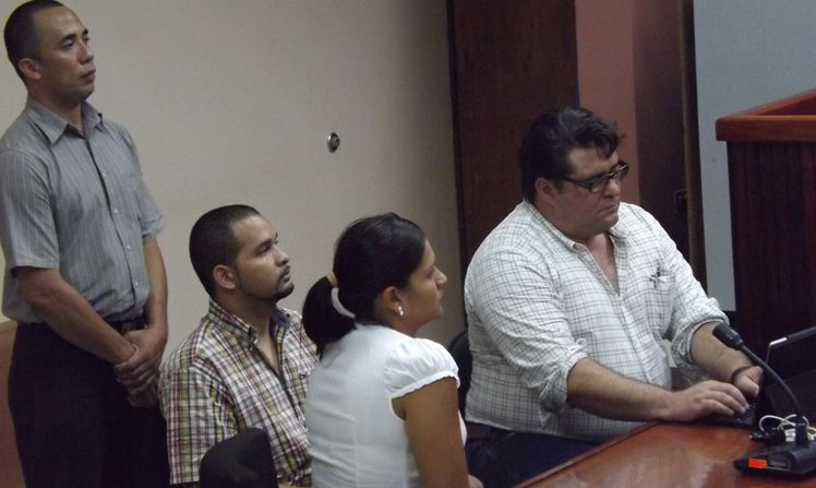 Chavez (sitting to the left) listens to the sentence on Monday.