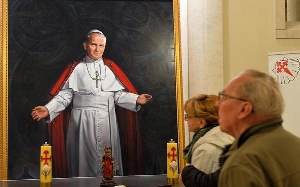 A couple visits the John Paul II Sanctuary in Krakow-Lagiewniki, Poland on April 6, 2014. In Poland late Pope John Paul II is a national hero and top moral authority — even today — and is beloved like nowhere else. (JANEK SKARZYNSKI/AFP/Getty Images)