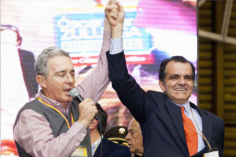 Former president Álvaro Uribe (left) and Oscar Iván Zuluaga, who came in first in Sunday's election, but not enough to take the presidency in the first round voting.