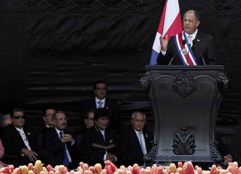Costa Rica's President Luis Guillermo Solis (R) addresses the audience as his counterparts (L-R) from Ecuador Rafael Correa, from Dominican Republic Danilo Medina, from Bolivia Evo Morales and from Guatemala Otto Perez sit near by. Reuters/Juan Carlos Ulate