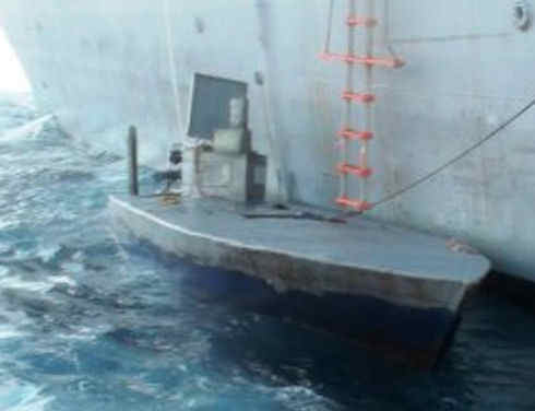 Colombian and U.S. naval units coordinated to seize 2.3 metric tons of cocaine from a semi-submersible vessel and arrest the three-man crew off the South American country's Pacific Coast as part of Operation MARTILLO, Colombian authorities said. (Courtesy of Colombian Navy)