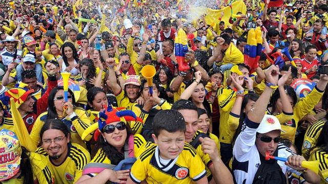Colombian fans celebrate during the fan fest in Cali, department of Valle del Cauca, Colombia, on June 28, 2014 as they watch the FIFA World Cup Brazil 2014 second round match between Colombia and Uruguay in a big screen. -- PHOTO: AFP