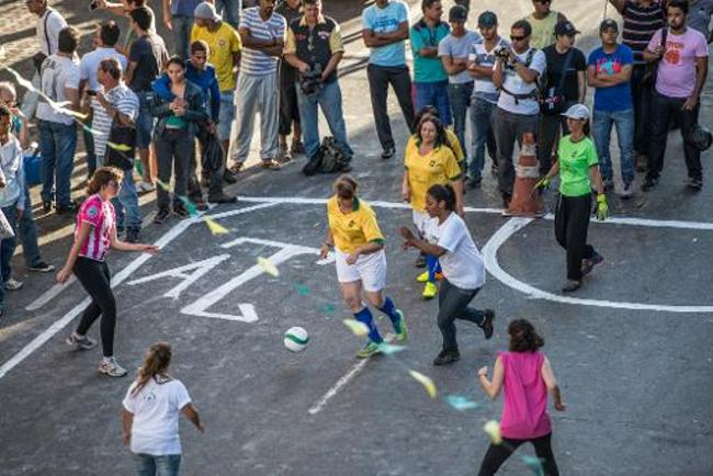 Prostitutes play a football match against a university team to protest against the exploitation of women in Belo Horizonte, Brazil on June 14, 2014 | Gustavo Andrade/AFP
