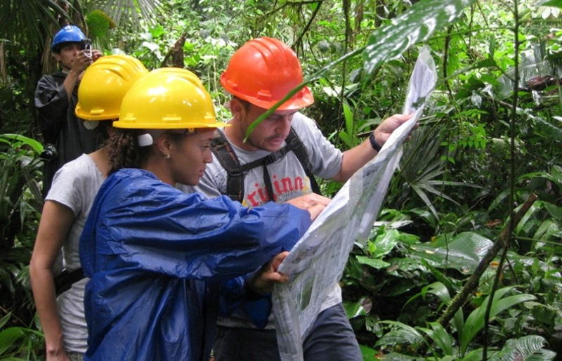 Auditors study a map during an on-site visit, as part of the FSC certification process.