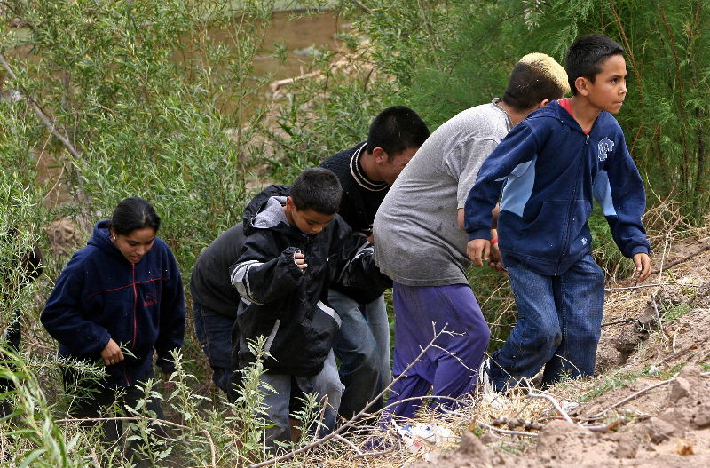 A Guatemalan family crossing the border from Mexico. Omar Torres/AFP/Getty