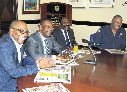 (From left) Bruce Blake of CONCACAF's legal team; Jeff Webb, CONCACAF president; Captain Horace Burrell, JFF president; and Danville Walker, managing director, Jamaica Observer, are all smiles during yesterday's Jamaica Observer Monday Exchange. (PHOTO: NAPHTALI JUNIOR)
