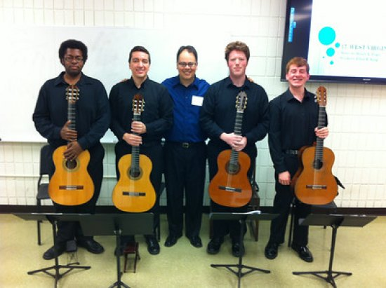 Marshall guitar ensemble students Kareem McCullough, Rodrigo Almeida, Jonathan Thorne and Erik Anderson stand with Associate Professor of Music and Brazilian native Dr. Julio Alves (center) before their trip to Costa Rica