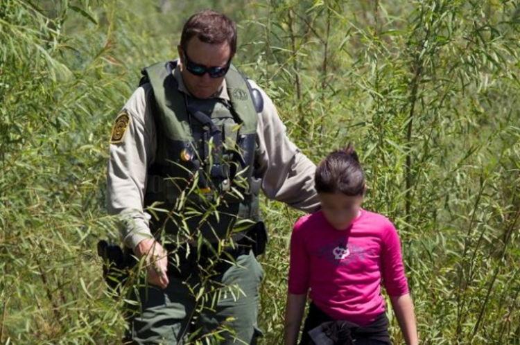 migrant-child-640-629x418