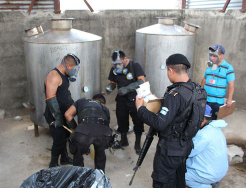 Officers with Guatemala's National Civil Police (PNC) are pictured in May dismantling a clandestine laboratory in Santa Rosa municipality used for making synthetic drugs. (Courtesy of Guatemala's PNC)