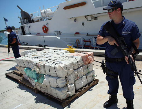 Above, the U.S. Coast Guard offloaded $27million worth of cocaine seized as part of the multilnational Operation MARTILLO in the Caribbean and Central America. Interdiction is one part of the international effort to counter illicit trafficking, but prevention and demand reduction is a much larger element of the U.S. Government strategy to counter the threat of illegal drugs. (Joe Raedle/Getty Images/AFP)