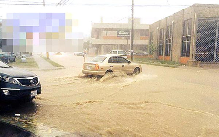 Flooding caused by clogged water sewers.