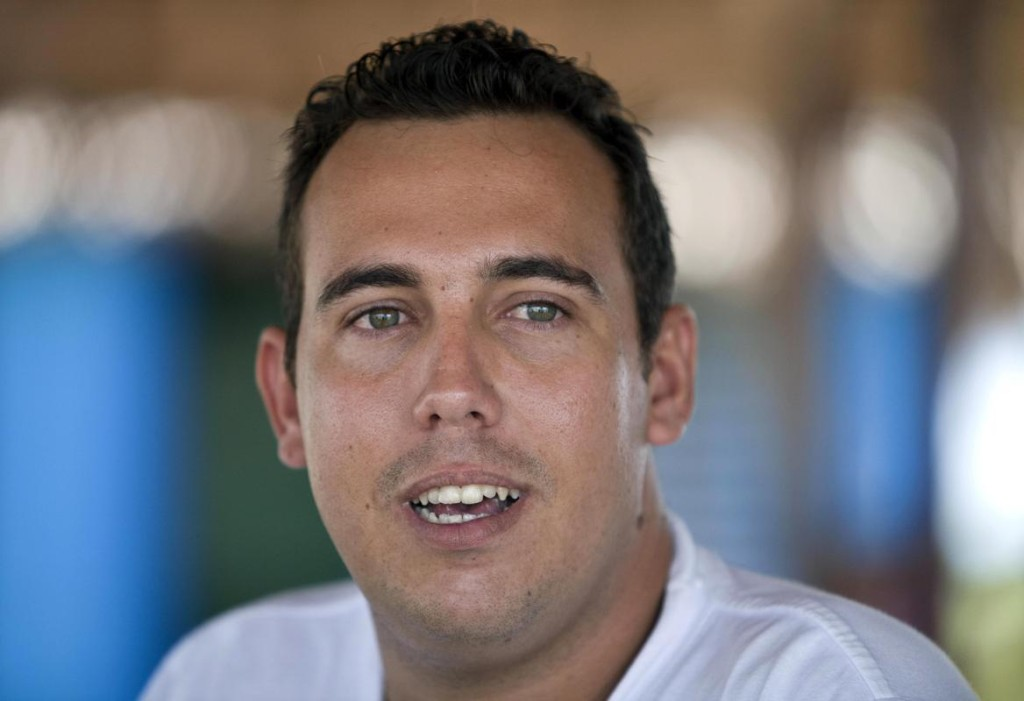 """In this July 12, 2014, photo, Hector Baranda, 26, speaks during an interview with The Associated Press in Santa Lucia, Cuba. Beginning as early as October 2009, a project overseen by the U.S. Agency for International Development sent Venezuelan, Costa Rican and Peruvian nationals to Cuba to cultivate a new generation of political activists. Baranda said his friendship with the foreigners began on the side of a road, a few years earlier, when he and his girlfriend were thumbing a ride. It's unclear any of the political objectives of the secret project were realized. Cubans contacted by the visiting foreigners were astonished to discover that they had been acting on behalf of the U.S. government. """"They were our friends,"""" said Baranda, who topped the Venezuelans' list of potential converts. (AP Photo/Franklin Reyes)"""