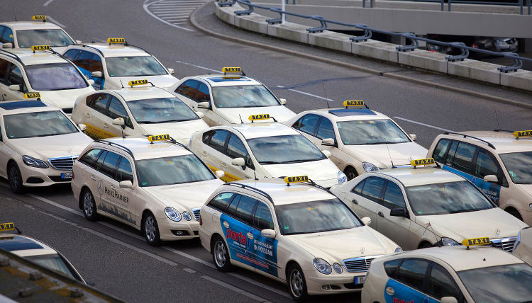 A rank of taxis sit outside Tegel airport in Berlin. Governments and regulators in cities around the world are restricting Uber's business on the grounds it poses safety risks and unfairly competes with licensed taxi services.