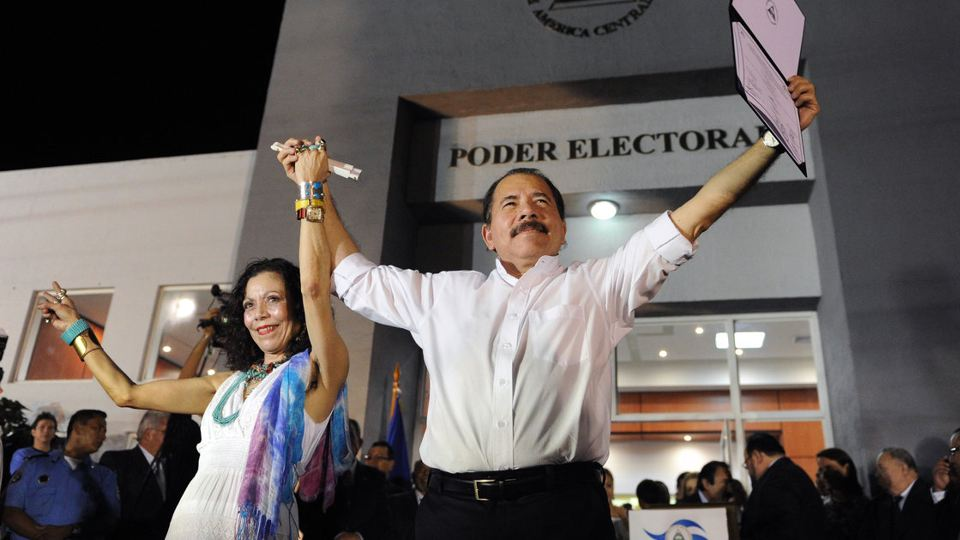 Nicaraguan President Daniel Ortega celebrates with first lady Rosario Murillo a day before his re-inauguration in 2012. Photo: Rodrigo Arangua/AFP/Getty Images