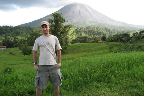 Michael Dixon in Costa Rica, the Arenal volcano in the background.