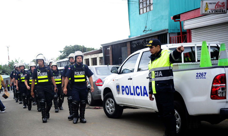 Police (Fuerza Publica) in action in the violent Desamparados, the dense poluplate community in Costa Rica, south of San José