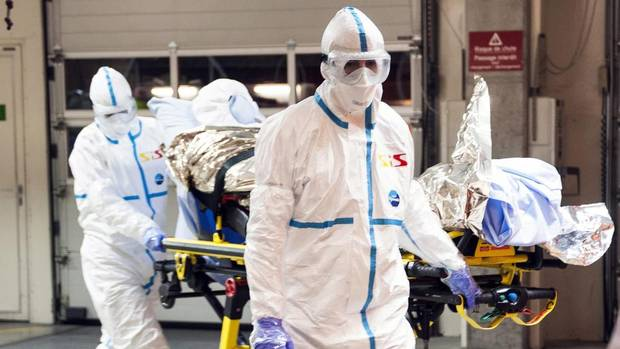 Cuban doctor Felix Baez Sarria, who contracted Ebola in Sierra Leone, arrives on a gurney at the Geneva University Hospital in Geneva, Switzerland, on Nov. 21, 2014. (AP)