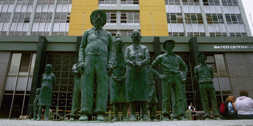 The statues at the front of the Banco Central building in downtown San José