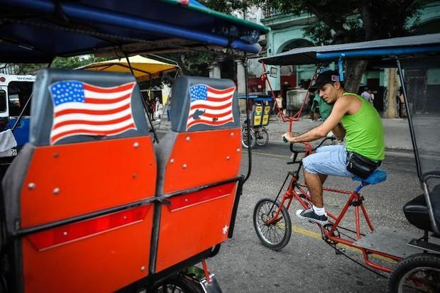 US flags adorn a pedicab in Havana on January 26, 2015 Yamil Lage, AFP