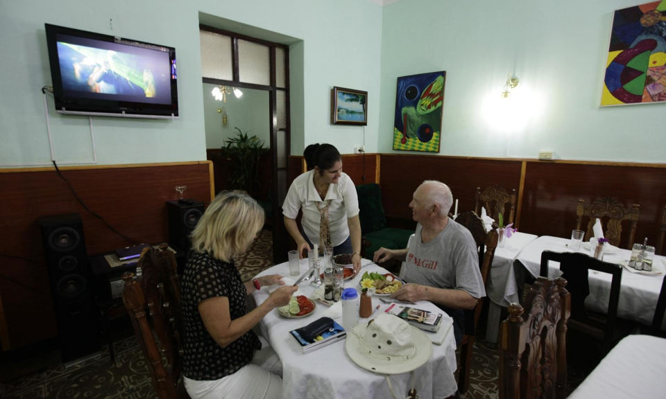 Tourists eat at a paladar or home restaurant in the town of Cienfuegos. Photograph: Desmond Boylan/Reuters