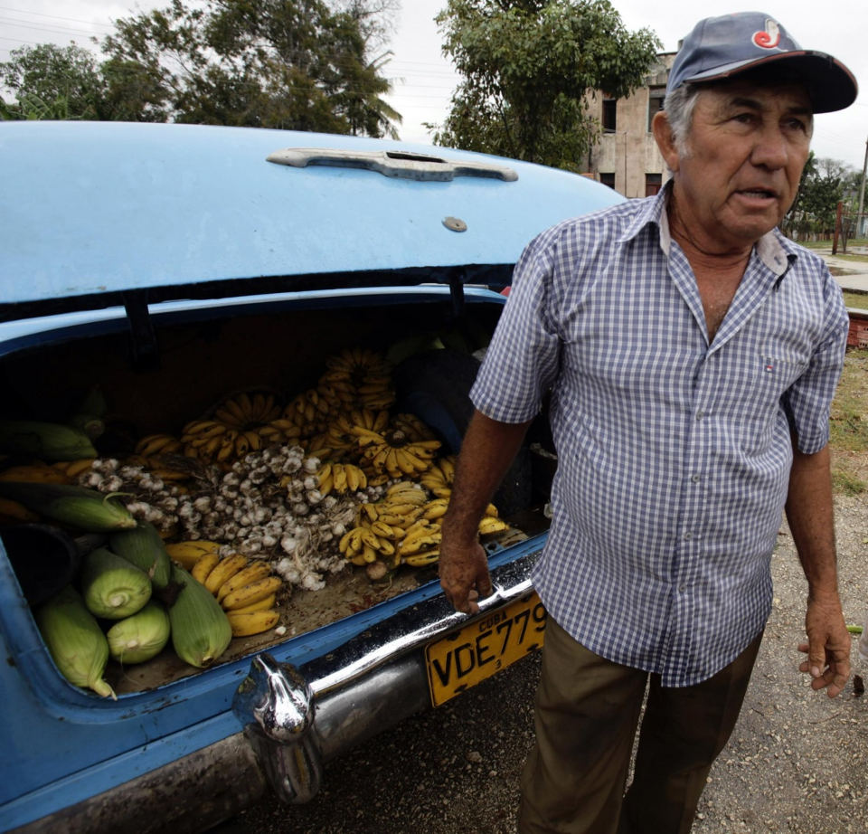 A farmer sells his produce out of the boot of his car at a market in the village of Sagua La Grande in central Cuba. Photograph: Desmond Boylan/Reuters