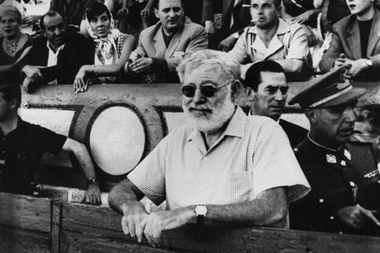 The original expat, American writer Ernest Hemingway, shown here at a Spanish bull-fight in Madrid.     Central Press/Getty Images