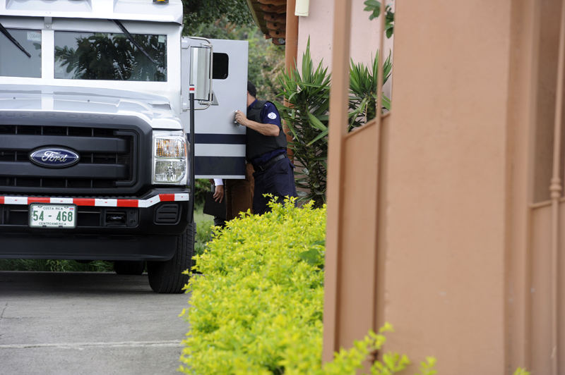 An armoured truck is used to transfer the drugs, cash and arms to police custody