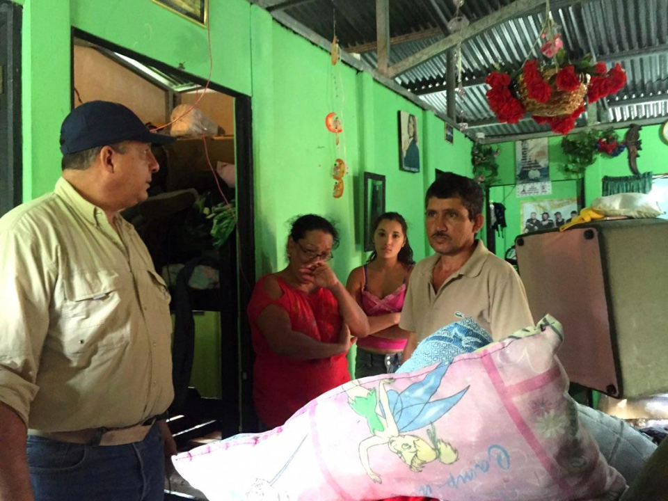 President Luis Guillermo Solis (left) over the weekend personally visited some of the affected.