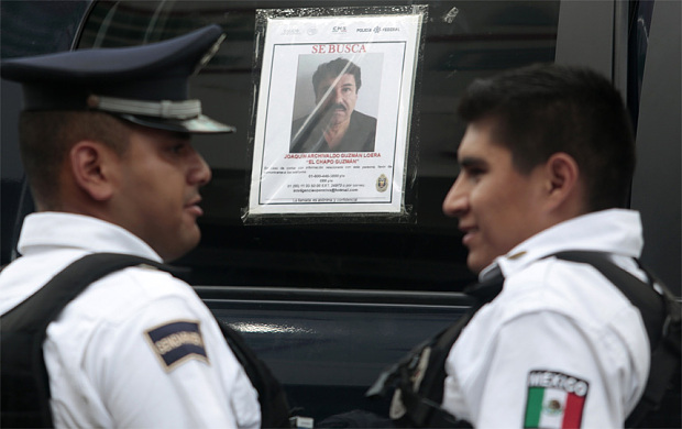 """A patrol car with a picture of fugitive drug lord Joaquin """"El Chapo"""" Guzman's on its window in Acapulco (AFP/Getty)"""