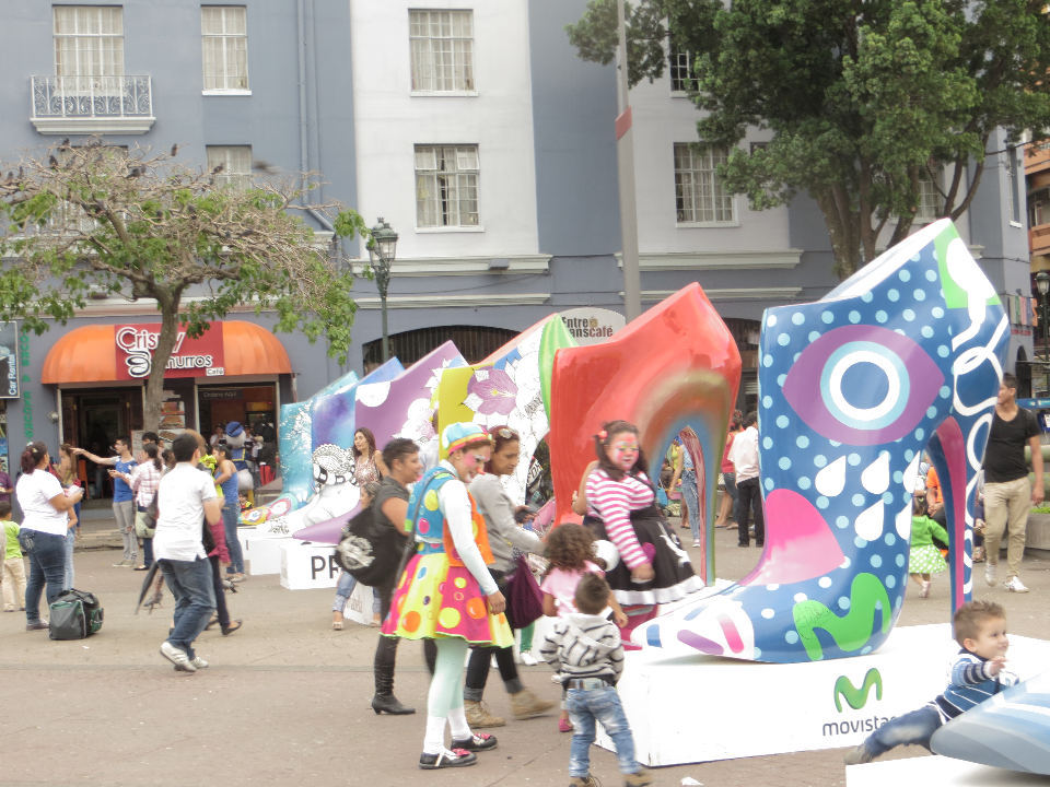 Ticos and tourists, kids and clowns all have a great time exploring the collection of giant shoes at the Plaza de la Cultura.
