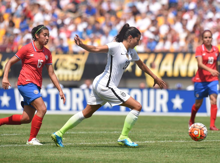 United States forward Christen Press (23) beats Costa Rica midfielder Cristin Granados (15) to score a goal during the first half of a women's friendly soccer match on Sunday, Aug. 16, 2015, in Pittsburgh. (AP Photo/Don Wright)