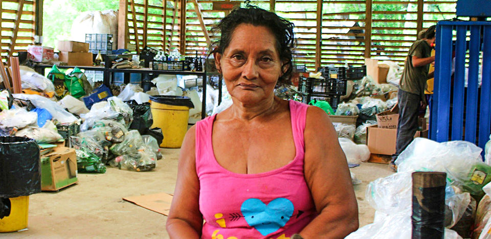 At age 64, her face reflects the hard life she has lived. Although she has problems with her knees, she only thinks about going to work every day.