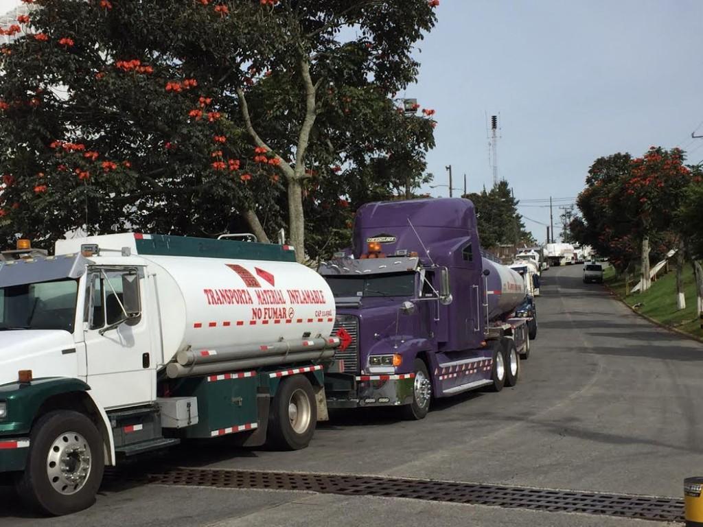Trucks line up to enter the Ochomogo fuel distribution centre in Cartago.