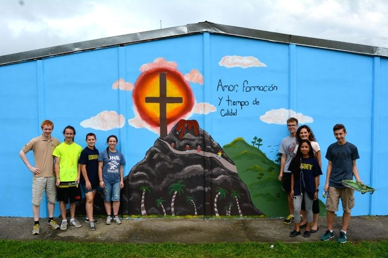 École Secondaire Sainte Marguerite d'Youville students Kevin Vossen, left, Matthew Beckman, Madison Bremault, Janessa Hill, Jeffrey Wright, teacher Nicole Schoenberger, Joanne Velasco, and Paulo Alves show off a new mural they painted at a school in San Jose, Costa Rica, as part of a volunteer trip earlier this month.