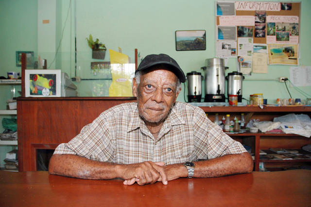 Walter Ferguson, age 87, has been making music his whole life. He plays guitar and sings calypso songs about life in Cahuita and the trials and tribulations of life. Here he sits in his family restaurant.