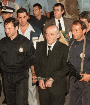 Klaus Barbie outside the Lyons court house following his sentencing on July 4, 1987. (Credit: STAFF/AFP/Getty Images)
