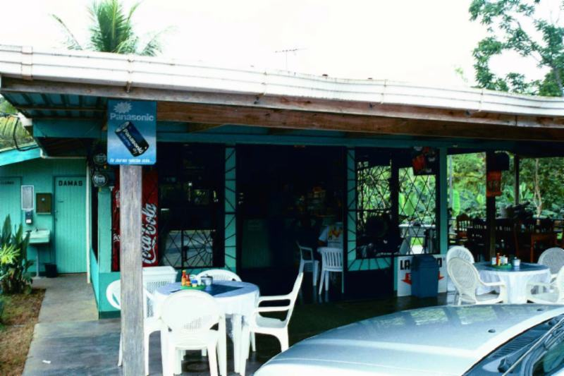In a typical Costa Rica soda (small eating place) kitchen employees (including the cooks) delivering the food to the tables