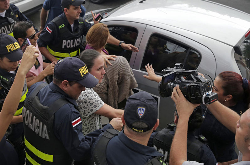 Syrian woman (covered) using false passport to enter Costa Rica was captured on Thursday, allegedly hiding out in a downtown San Jose hotel. Photo Albert Marin, La Nacion