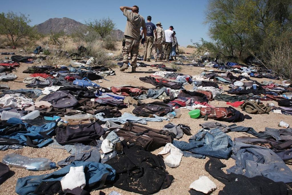 """Thirty miles from the Mexican border, in the Altar Valley in Arizona, """"Minutemen"""" patrol a remote stretch of the Sonoran desert where migrants have abandoned their belongings. photograph by Andrew Lichtenstein"""