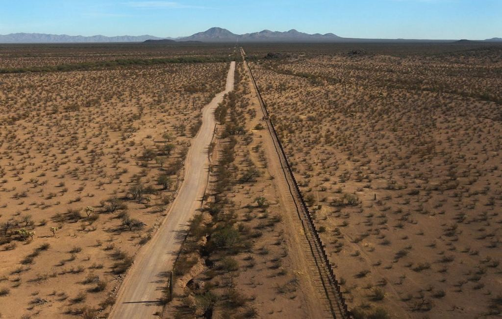 Fences, like this one stretching through Tohono O'Odham Nation tribal lands in Arizona, have done little to stem the flow of migrants. photograph by John Moore, Getty Images