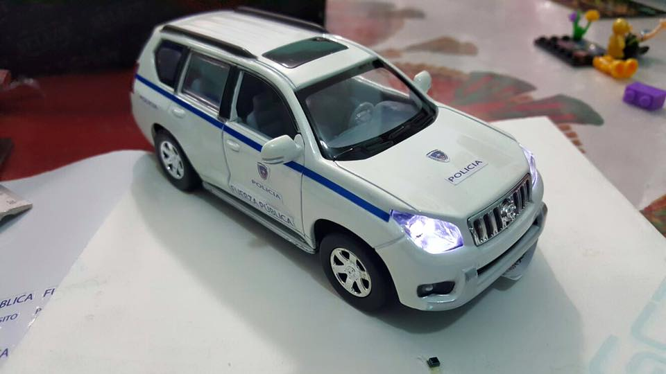 The toy police car is battery powered to turn on the lights and the sound of the engine